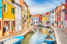 Colorful Houses With Boats In Burano Island With Cloudy Blue Sky Near Venice, Italy. Popular And Famous Tourist Place.