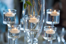 Candles Floating In Stemware F...