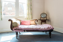 Antique Chaise Longue In The Corner Of An Old Room