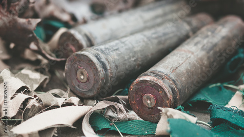Photo bullet shells from heavy machine gun on the table with camouflage netting