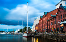 Scenic Summer Evening Panorama Of The Old Port Pier Architecture With Tall Historical Sailing Ships, Yachts And Boats In The Old Town In Helsinki, Finland