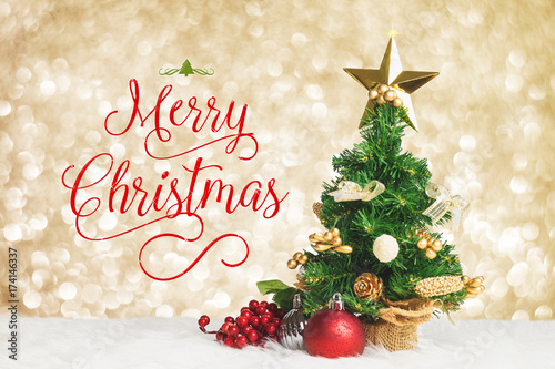 Fotografia Merry Christmas work with xmas tree with cherry and ball decorate on white fur with golden silver bokeh sparkle light background,Holiday greeting card