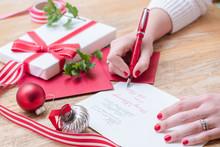 Young Woman Writing Christmas ...