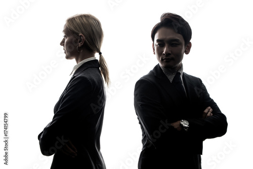 Fotografía Silhouette of man and woman standing back to back.