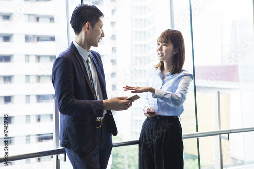 A business couple is talking on the window Canvas Print