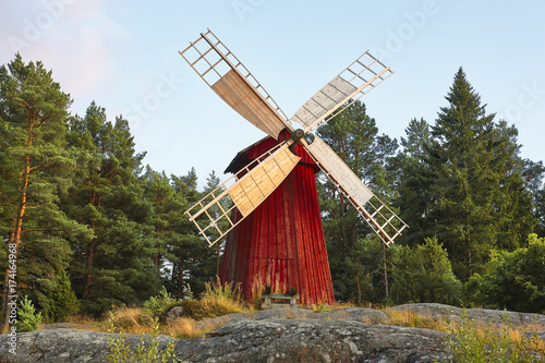 Poster Molens Antique traditional wooden windmill in Finland. Picturesque finnish countryside