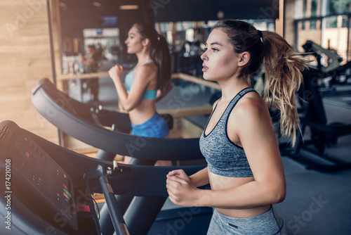 Photo Stands Fitness Sports women in gym