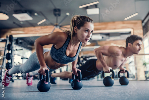 Photo Stands Fitness Couple in gym