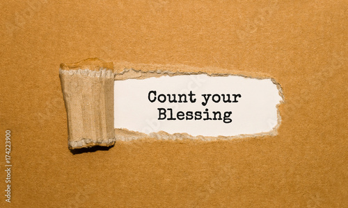 The text Count your Blessing appearing behind torn brown paper Canvas Print