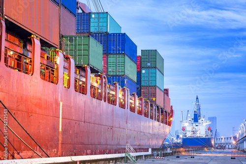 Valokuva  Transportation port shipyard import export concept, Container on the ship at por