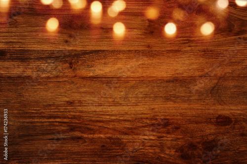 Fototapeta Dark wooden background with bokeh effects obraz na płótnie