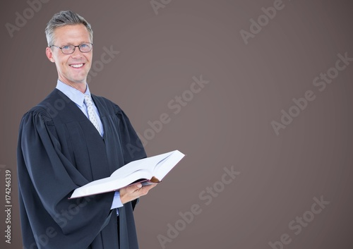 Photo Male judge with open book against brown background