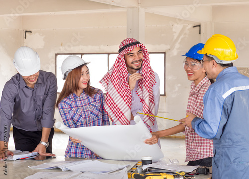 Engineer, architect and arab businessman planing for project construction buildi Wallpaper Mural