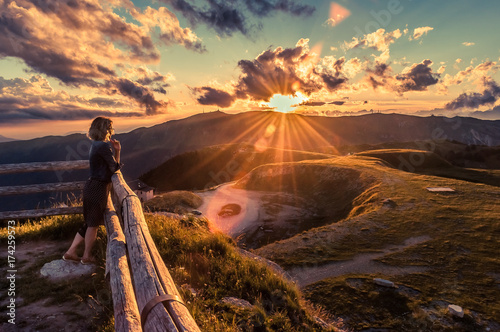 Girl watching a beautiful sunset in a peaceful and tranquil place, Mount Pizzoc Fototapeta