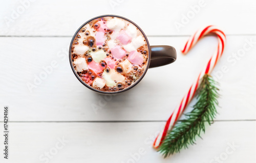 Spoed Foto op Canvas Chocolade Hot cocoa mug with marshmallows on white wooden table. Winter time hot chocolate, Christmas cozy home concept