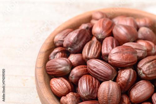 Valokuvatapetti jojoba seeds on the table