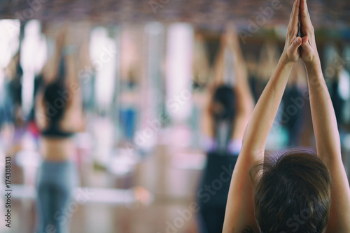 Group of girls to exercise, yoga in the studio