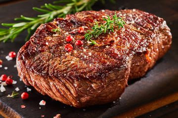 Fototapeta Do steakhouse Piece of roast beef with spices
