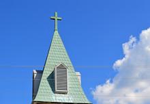 Old Christian Cross On A Churc...