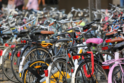 Deurstickers Amsterdam large parking lot with thousands of bicycles