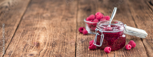 Raspberry Jam on wooden background; selective focus