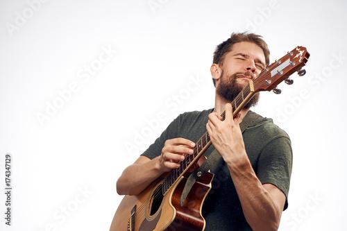 man plays the guitar and enjoys it - 174347129