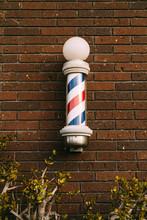 Barber Pole On A Brick Wall