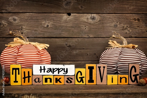 Shabby Chic Happy Thanksgiving Wood Sign With Cloth Pumpkins Against A Rustic Wooden Background