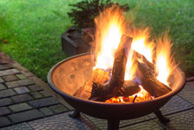 A Portable Fireplace With Brig...