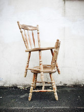 Two Wooden Chairs Stacked By A...