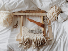 Working On A Weaving Loom In Bed