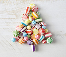 Colorful, Hard, Candy Pieces Arranged In Tree Shape On White Surface
