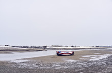Boats And Snow At Low Tide. Bu...