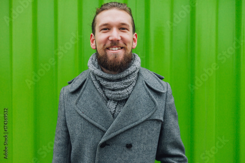 Man in front of the green background