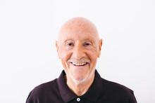 Portrait Of An Elderly Man Standing Over White.