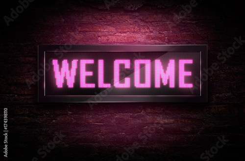 Welcome Led signage on brick wall Canvas Print