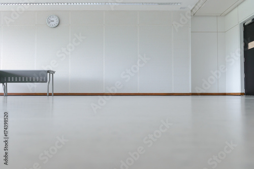 Fényképezés  Empty room modern interior - floor with soundproof wall, door, clock and table