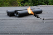 canvas print picture - Heating and melting bitumen roofing felt Flat roof installation