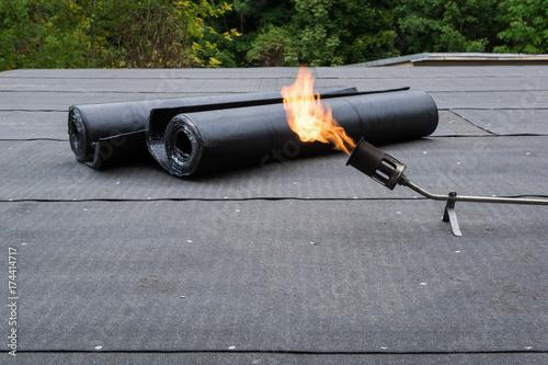 Heating and melting bitumen roofing felt Flat roof installation Canvas Print