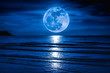Leinwanddruck Bild - Super moon. Colorful sky with cloud and bright full moon over seascape.