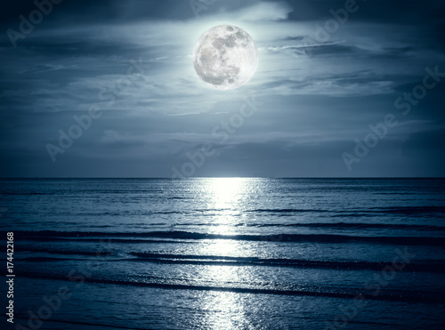 Keuken foto achterwand Volle maan Colorful sky with dark cloud and bright full moon over seascape.