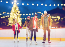 Happy Friends On Christmas Skating Rink