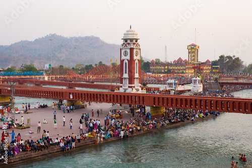 Holy ghats and temples at Haridwar, India, sacred town for Hindu religion. Pilgrims praying and bathing in the Ganges River.