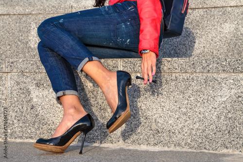 broken stiletto heel on the shoes wearing on your feet girls Fototapeta
