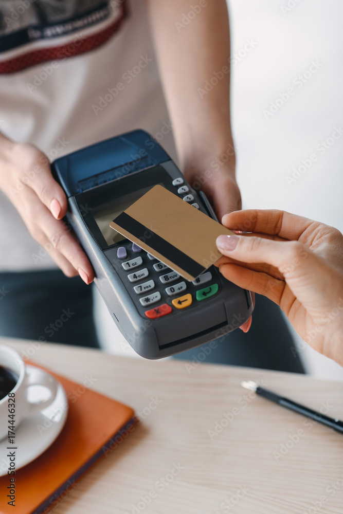 Fototapeta Payment with credit card and terminal