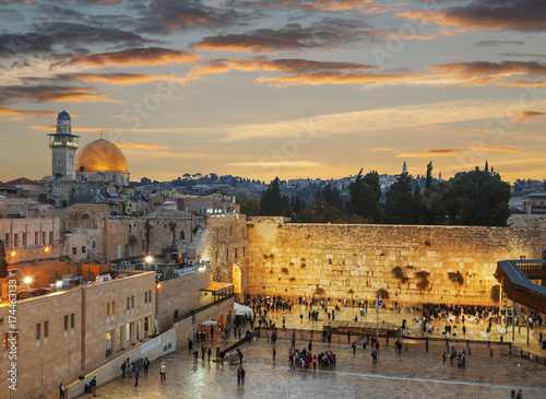 The wailing Wall and the Dome of the Rock in the Old city of Jerusalem at sunset, Israel