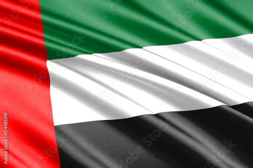 Plakat macha flagą Zjednoczone Emiraty Arabskie