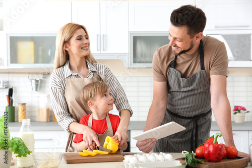 Poster Cuisine Family cooking in kitchen. Cooking classes concept