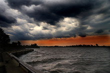 Dark Storm Clouds Over Lake
