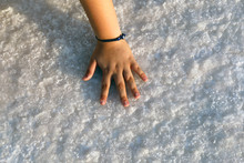 Girl Hand On Salt At Salt Lake In Aksaray,Turkey